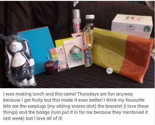 A young person's Care Package with a caption explaining their favourite parts of it - the earplugs, bracelet and pronoun badge.